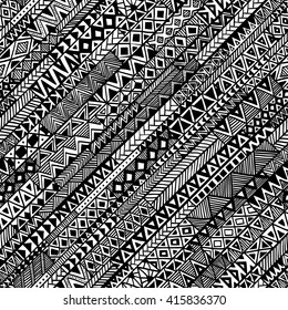 Diagonal seamless geometric background painted by hand. Ethnic and tribal motifs. Black and white vector illustration. Print fabric.