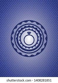 diamond ring icon inside badge with denim texture