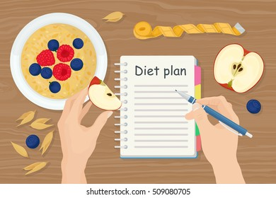 Diet plan with oatmeal porridge in bowl. Apple, berry, oats isolated on wood background