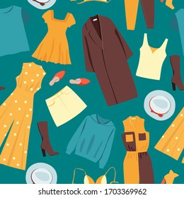 Different clothes on a green background. Seamless pattern