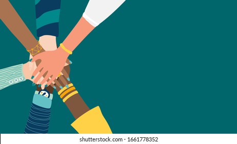 Different people join hands in a fit of teamwork. A group of people strives for a common goal in their work. Together strength, confidence and result. Friendship and helping each other in unity.