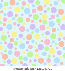Different sized pastel polka dots on a light blue vector background.