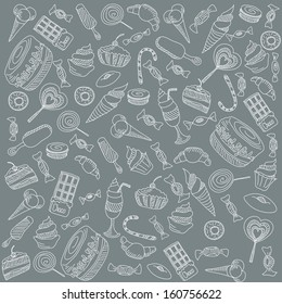 a lot of different sweets on a gray background