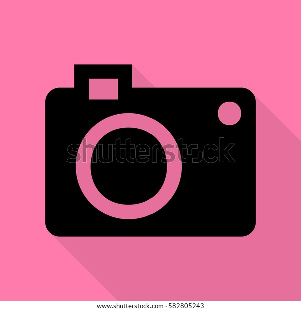 Digital camera sign. Black icon with flat style shadow path on pink background.