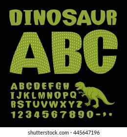 Dinosaur ABC. Font of prehistoric reptile. Green letters. Texture of skin of lizard. Dino Monster alphabet. Set of ancient animals type