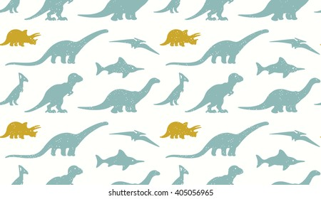 Dinosaurs silhouettes on white background. Seamless pattern