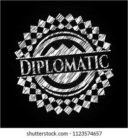 Diplomatic chalk emblem written on a blackboard