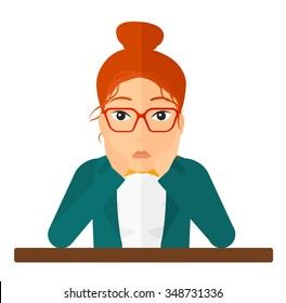 A disappointed young woman sitting at the table and clutching her head vector flat design illustration isolated on white background. Square layout.