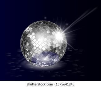 Disco ball abstract background. Silver disco ball on floor shine in dark.