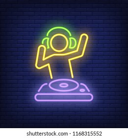 Disk jokey with dj mixer neon sign. Music, party and sound concept. Advertisement design. Night bright neon sign, colorful billboard, light banner. Vector illustration in neon style.