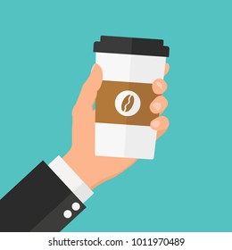 Disposable coffee cup in hand. Flat design illustration