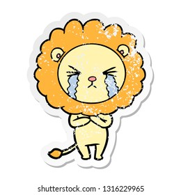 distressed sticker of a cartoon crying lion