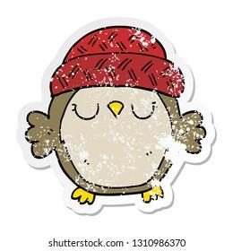 distressed sticker of a cute cartoon owl in hat