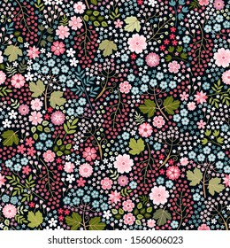 Ditsy floral seamless pattern with pink and blue flowers, green leaves and purple berries. Summer field. Beautiful print for fabric, textile, wrapping paper.