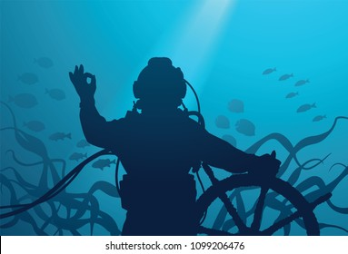 Diver with ship's steering wheel showing OK sign