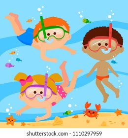 Diverse group of children with diving masks swimming under the sea.