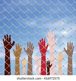 Diversity hand silhouettes behind metal wire fence against blurry sky background.