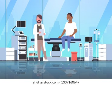 doctor visiting african american man patient sitting on operation table healthcare concept hospital room interior modern equipment medical clinic horizontal full length