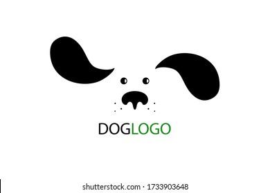 Dog logo design. Cute cartoon dog face with long fluttering ears. Vector illustration