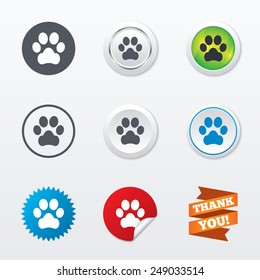 Dog paw sign icon. Pets symbol. Circle concept buttons. Metal edging. Star and label sticker. Vector
