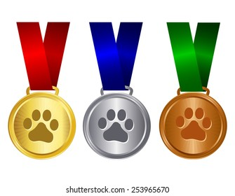 Dog show winners award medal gold , silver and bronze with red blue and green ribbons and paw print on center