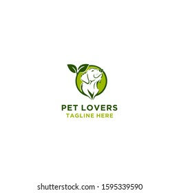 Dog silhouette head logo with green leaf logo vector template.