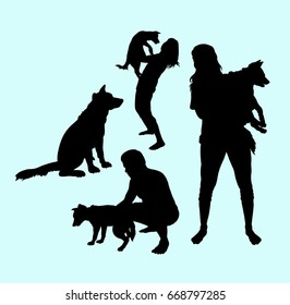 Dog training male and female activity silhouette. Good use for symbol, icon, sign, mascot, sticker, or any design you want.