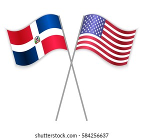 Dominican and American crossed flags. Dominican Republic combined with United States of America isolated on white. Language learning, international business or travel concept.