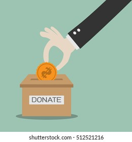 donate money and charity concept man throws gold coin in a box for donations hand donation