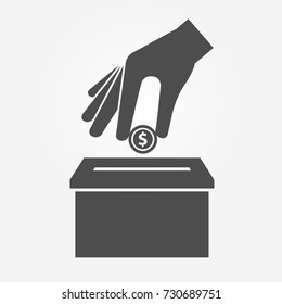 Donation icon concept. Hand putting coin in the box