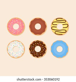 Donut vector set isolated on a light background in a modern flat style. Donuts into the glaze collection.