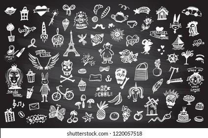 Doodle graphic line elements set on a chalkboard, hand drawn illustration symbols collection