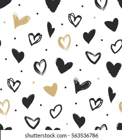 Doodle hearts in black and gold seamless pattern. Hipster simple pattern for wrapping paper or background.
