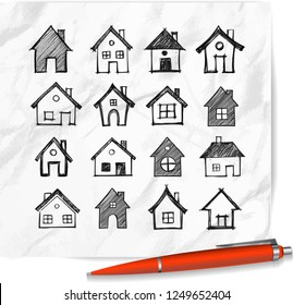 Doodle houses on realistic white paper background.