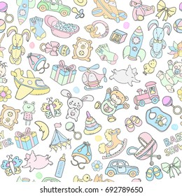 Doodle vector babyshower seamless pattern with hand drawn toys. Perfect for printable design products for children like fabric, wallpaper, greeting cards.