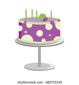 A dot decorated birthday cake in purple and green with unlit candles