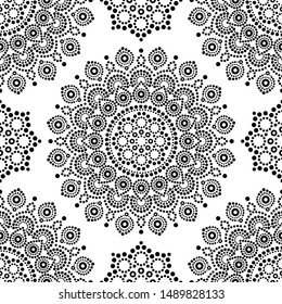 Dot painting monochrome vector seamless pattern with mandalas, Australian ethnic design, Aboriginal dots pattern in black and white background.   Abstract mandala with dots design