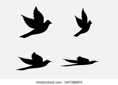 Dove silhouettes , peace symbol. Vector pigeon with spread wings . Holy bird in Christianity, freedom of purity, flight of animal poses isolated