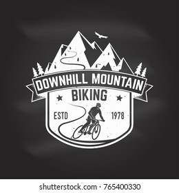 Downhill mountain biking. Vector illustration. Concept for shirt or logo, print, stamp or tee. Vintage typography design with man riding bike and mountain silhouette. Chalk drawing on a blackboard.