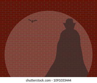 A Dracula and a bat shadow in a spotlight against a brick wall