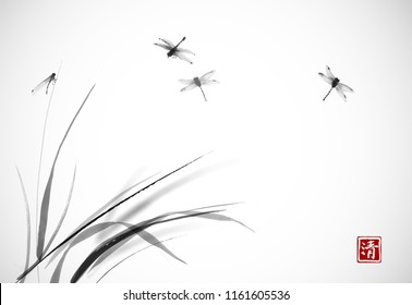 Dragonflies flying over the grass. Traditional oriental ink painting sumi-e, u-sin, go-hua. Hieroglyph - clarity
