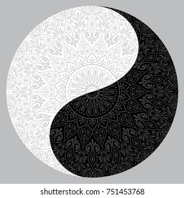 Drawing of a black and white mandala, round ethnic ornament in shape of symbol yin yang