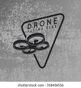 Drone logo concept on grey grunge background