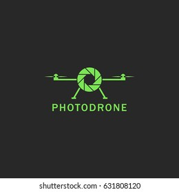Drone logo flat style green flying copter with abstract lens photo camera emblem mockup. Helicopter delivery concept, simple unmanned aerial vehicle technology icon UAV.