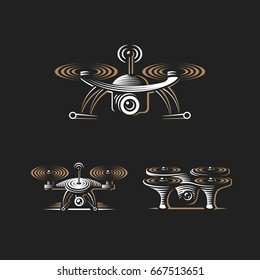 Drone quadrocopter logo design set, emblem on dark background EPS 10