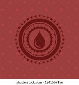 drop icon inside retro red emblem