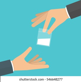 Drug dealing concept. Hand giving a plastic bag filled with powder to another hand