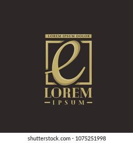 E letter logo . E icon gold design