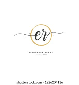 E R ER Initial letter handwriting and  signature logo.