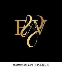E & V / EV logo initial vector mark. Initial letter E & V EV luxury art vector mark logo, gold color on black background.